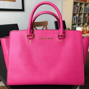 Bright Pink Michael Kors purse.